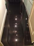 GRANITE FLOOR TILE REFLECTS TRACK LIGHTING